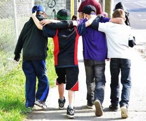 Neighbourhood kids walking arm in arm